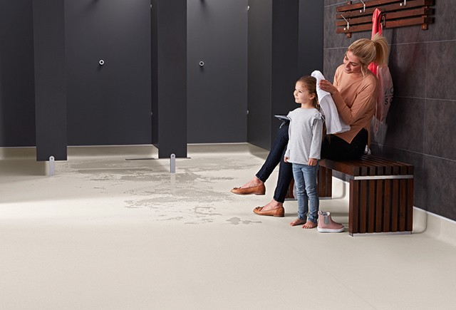 Safety flooring in a locker room | Markville Carpet & Flooring