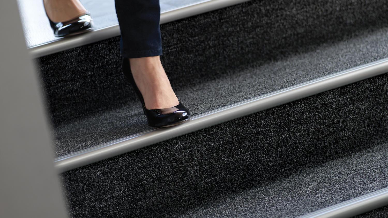 Woman walking down stairs | Markville Carpet & Flooring
