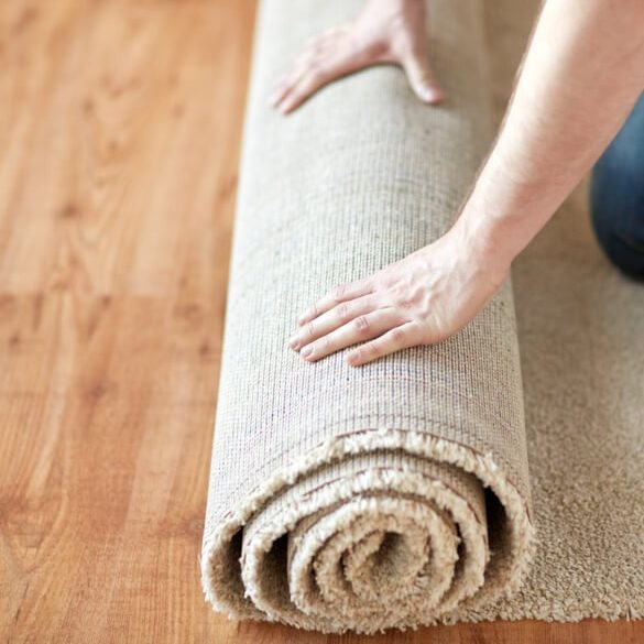 Carpet rolling by man | Markville Carpet & Flooring