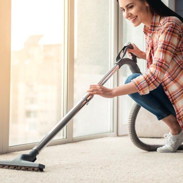 Vacuuming carpet | Markville Carpet & Flooring