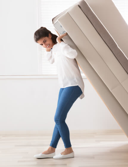 Woman moving furniture | Markville Carpet & Flooring