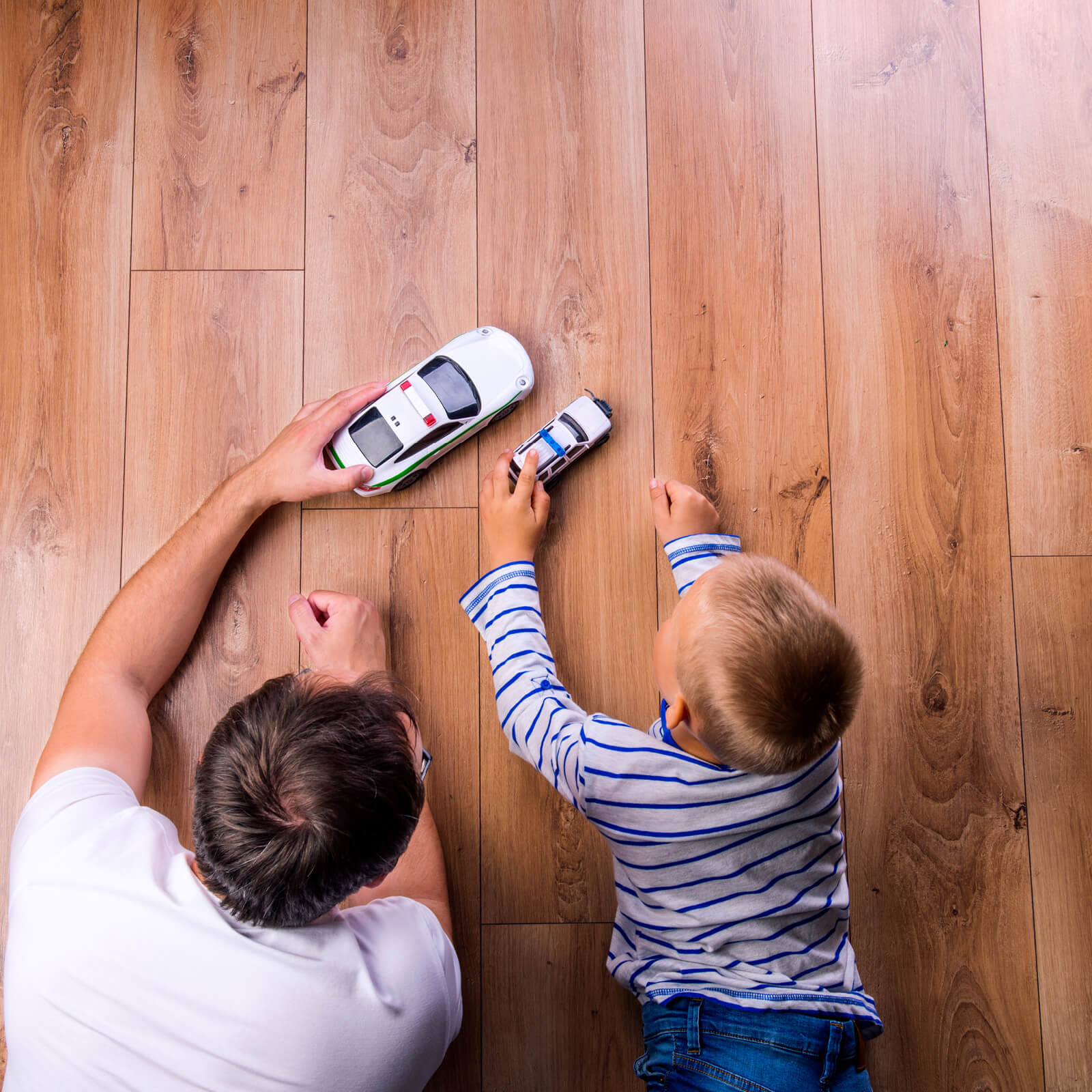 Dad and child on hardwood flooring | Markville Carpet & Flooring